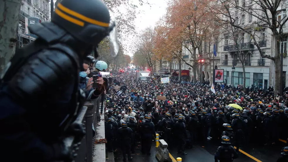 More than 140 arrested at new Paris protest against law that would limit filming police